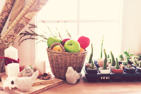 Artificial Fruits in a basket on wood table. Home decoration.