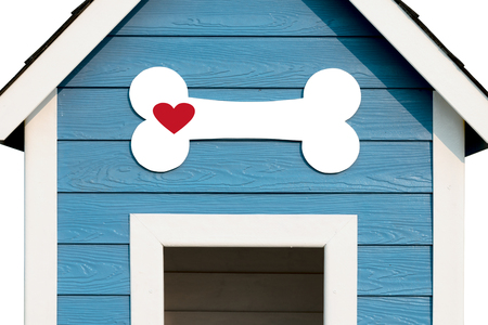 Love  Dog Concept.  White bone with red heart shape in front of Dog House. Stock Photo