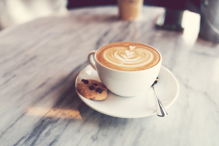 Soft focus on A cup of hot coffee (Latte) on table. Stock Photo