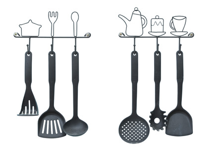 Collection of ladles hanging on white background. This has clipping path. Stock Photo