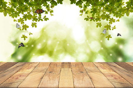 Brown Wooden table with green blurred  background. Empty table for display product. Stock Photo