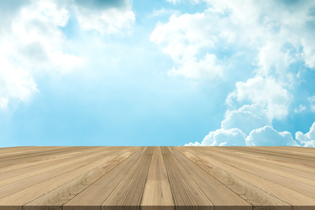 Brown wooden floor for display product and blue sky background.