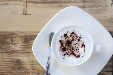 Soft focus on A cup of Cappuccino on table. Top view. Stock Photo