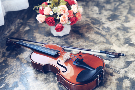 Violin with bow placed on the floor.