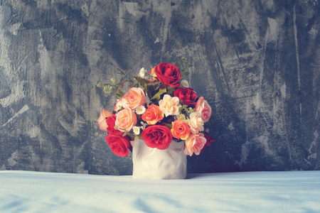 Artificial flowers bouquet in a pot. Bedroom decoration.
