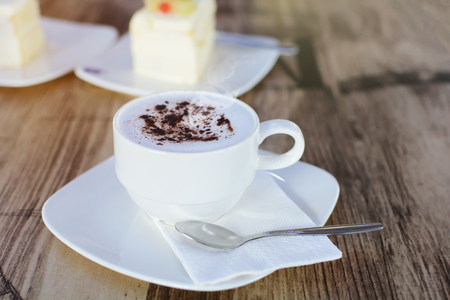 Sof focus on A cup of Cappuccino on table. Stock Photo