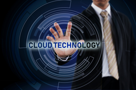 Cloud Technology concept and Businessman hand in background. Stock Photo