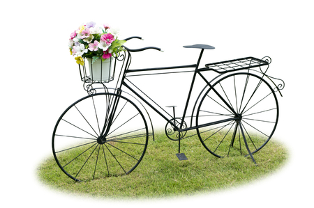 Vintage bicycle on green grass isolated on white background. Stock Photo