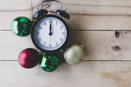Retro alarm clock and Color Balls on wooden floor. Abstract background for Christmas and Happy New Year. Reklamní fotografie
