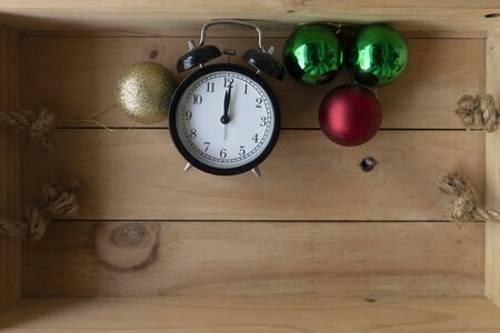 Retro alarm clock and Color Balls on wooden box. Abstract background for Christmas and Happy New Year. Stock fotó
