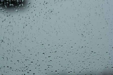 Water Rain drops on the car glass. The rainy season is a time when drivers must be careful of slippery roads. May cause accidents more easily.