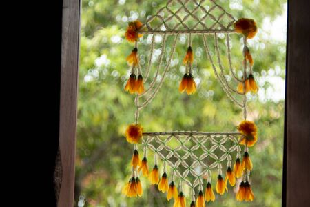 Traditional Thai Style Window Decoation with Flower mobile. Using Thread of flowers and then decorate it on the frame of the door or window