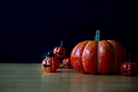 Pumpkins on wood table. Halloween holiday background. Stock fotó