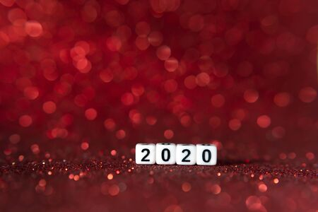 The cube2020 and Red Lighting blurred background. Merry christmas and Happy New Year Concept.