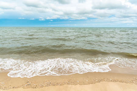Quiet beach and the sky with clouds. Nature background.