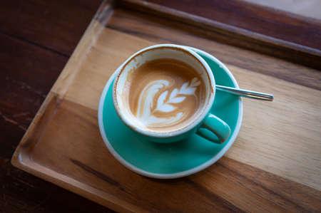 A Cup of Coffee. Hot Latte Art. Фото со стока