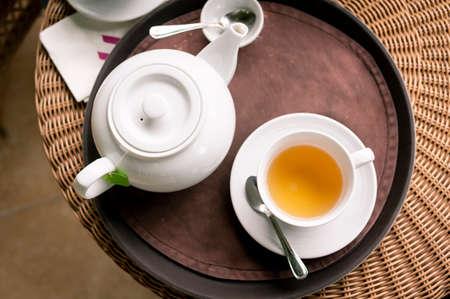 Tea pot and Tea cup on  wooden table Фото со стока
