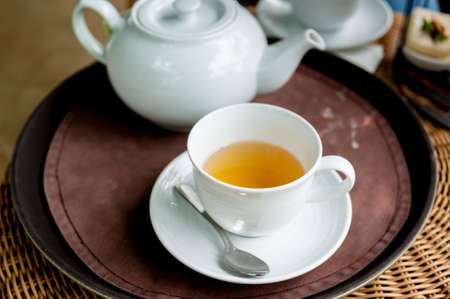 Soft focus. Hot Tea Cup on  wooden table
