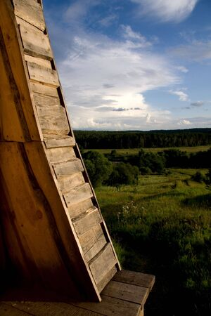 Rural view with part of wooden building close-up. photo