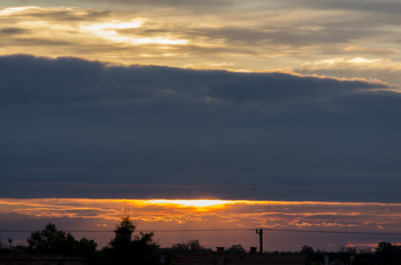 Cloudy sky at sunset over the suburbs of Szeged, in Hungary.