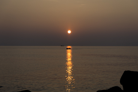 Silhouette of boat at the sunset beach on Koh Kood in Thailand. Stock Photo