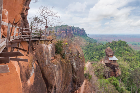Unseen in thailand and amazing thailand,Phu tok mountain or Wat Jetiyakiree Viharn Temple with wooden trail round of the 7 floors mountain at Bueng Kan Province Stock Photo