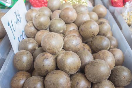 arhat: arhat fruit put up for sale in a bazaar Stock Photo