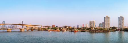 Panorama, scenic capital of Thailand is Bangkoks Chao Phraya next to Krung Thep Bridge. Stock Photo