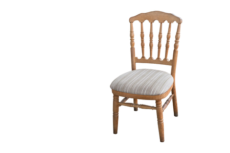 Old-fashioned wooden carved wooden chair, isolated on white background Stock Photo