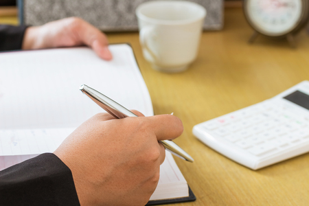 Businessman working Make notes on the table