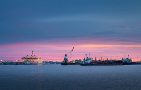 Cargo ship parked in the evening.