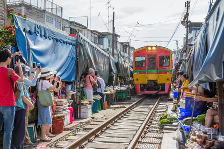 MAEKLONG, THAILAND-September 10: The famous railway markets at Maeklong, Thailand,September 10 th, 2017, Bangkok, Thailand.six times a day the train runs through these stalls.