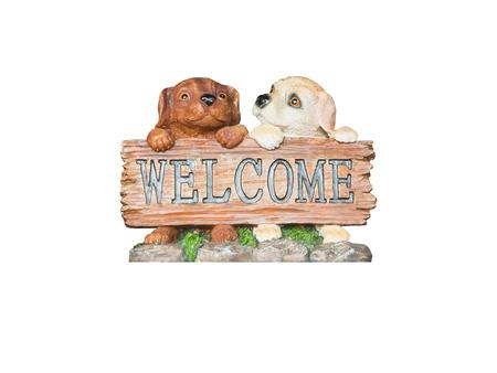 犬の像のウェルカムサイン.クリッピングパスと白い背景に隔離。 写真素材