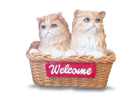 Cats dolls made of ceramic are in the basket,vintage phone , isolated on white background with clipping path.