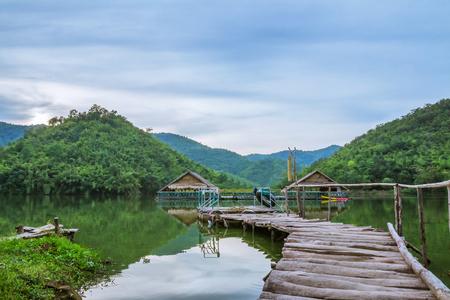 The wooden bridge extends into the reservoir.