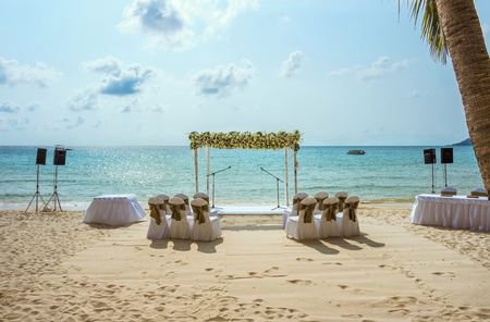Wedding on the beach . Wedding arch decorated of flowers on tropical sand beach. Wedding and honeymoon concept. Stock Photo