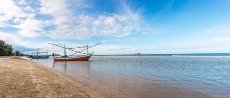 Panoramic sea view, sea view with fishing boat parked on the beach