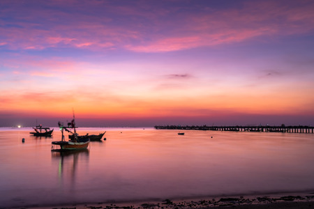 Long exposure, Beautiful sunset view with wooden jetty . Nature composition. 写真素材