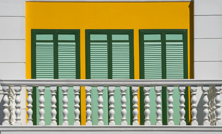 White balcony with yellow wall, vintage style