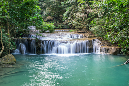 Erawan water fall, tropical rainforest at Srinakarin Dam, Kanchanaburi, Thailand.Erawan water fall is  beautiful waterfall in Thailand. Unseen Thailand - Image 写真素材