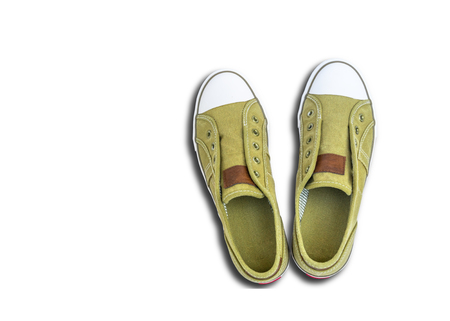 Green sneakers,isolated on white background with clipping path. 写真素材