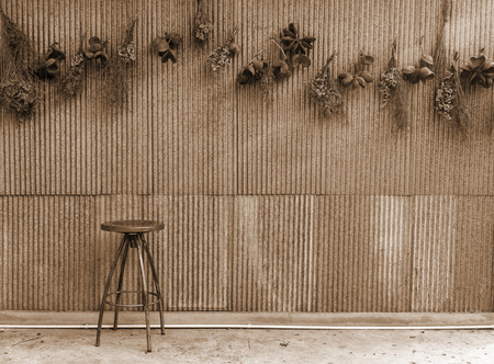 Wooden chair with zinc wall, vintage style 写真素材