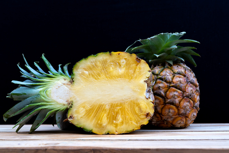 Half pineapple cut on a black background 写真素材