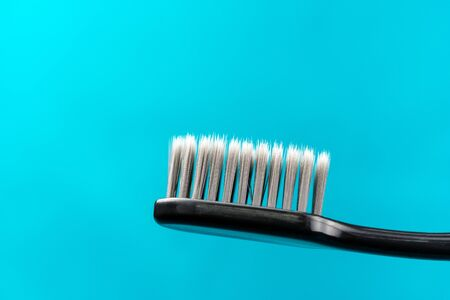 Charcoal Toothbrush on a green background Stock Photo