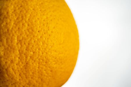 macro of the texture skin orange grapefruit  on the white wall background. Close up.