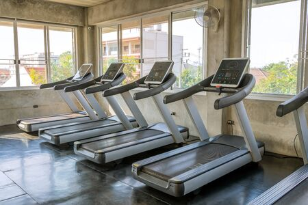 treadmill in a gym without people exercising