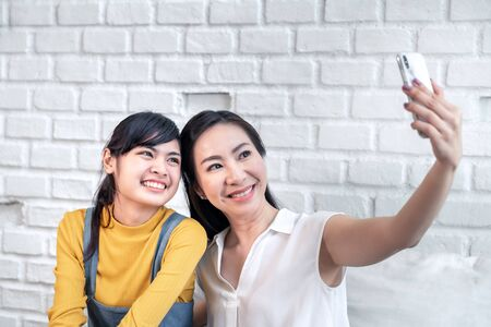 Southeast Asian mother and daughter are happy selfies