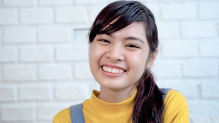Close up of cute Southeast Asian teenagers are smiling bright and cute