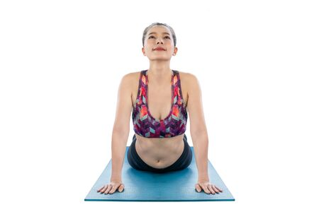 Asian girls are planking in exercise on a yoga mat.isolated on white background with clipping path