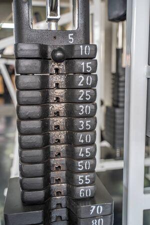 Stack of metal weights in gym bodybuilding equipment